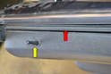 With all the clips free you want to lift the panel up and out from the channel on the top of the door (red arrow).