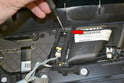 Use a small flathead screwdriver and gently pry off the plastic cover on the back of the switch (red arrow).