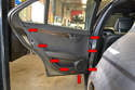 There are eight clips (red arrow) that hold the door panel in place.