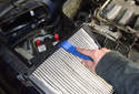 Pull out the cabin air filter housing and flip it over.