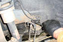 Front Brake Hose ThisPicture illustrates the right side wheel house just in front of the strut.