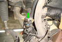 Front Brake Hose Pull the rubber brake hose (green arrow) out of the bracket.