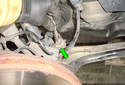 Front Brake Hose The brake hose is held in place by a grommet (green arrow).