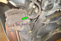 Rear Brake Hose Using a 14mm line wrench (green arrow) loosen the brake line connection on the caliper side.