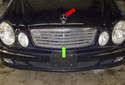 The radiator grille consists of one grille (green arrow) mounted in the hood.