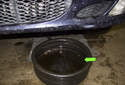 Place a five-gallon bucket (green arrow) under the left side of the radiator.