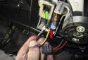 Start by connecting two fused jumper wires to the final stage blower motor output connector (red arrow).
