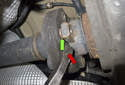 With all the fasteners removed, use a pry bar to lever the Giubo (red arrow) out of the differential flange (green arrow).