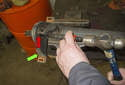 To replace the center bearing, place the driveshaft in a vise.