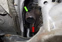 If you broke a fastener during removal, cut the fastener (red arrow) so about one-inch hangs out of the manifold.