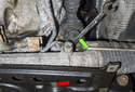 This photo shows how to access the nuts with a wrench (green arrow) on the rack side, when removing the 16mm bolts (red arrow).