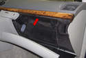 The first step is to remove the trim panel surrounding the latches (red arrow).