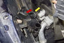 Pull the heater valve out of (yellow arrow) the heater core connections toward the engine.