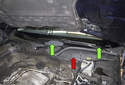 The wiper arms (green arrows) are driven by a motor (red arrow) located beneath the wiper cowl trim.