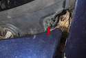 Working at the left side of the wiper cowl, remove the plastic Phillips head screw (red arrow).