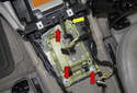 Remove the three 10mm shift selector module mounting fasteners (red arrows).