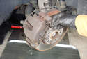 With the top of the spring removed pull out the bottom and remove from the caliper