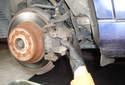 Rear Brake Rotor Remove the caliper from its brake caliper bracket.