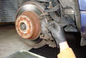 Rear Brake Rotor Remove the outer brake pad from the caliper bracket.