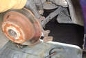 Rear Brake Rotor Remove the caliper bracket from the spindle.