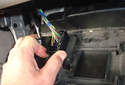 Next you have to remove the OBDII plug from the panel.