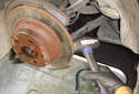 If the brake rotor is stuck on the hub you can use a hammer to tap it off.