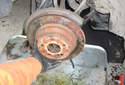 Pull the brake rotor off of the hub flange.