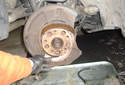 Now you can pull the parking brake shoes apart from around the hub flange with only one spring holding them together.