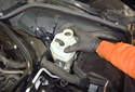 Remove the brake fluid reservoir by lifting it straight up from the brake master cylinder.