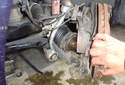 Move the spindle out of the way and remove the axle shaft outer CV joint from the spindle.