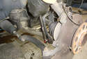 This picture illustrates the right side wheel well looking at the lower control arm from the rear.