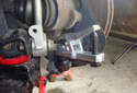 Using a ball joint removal tool, force the ball joint out of the spindle.