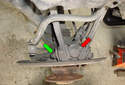 This picture illustrates a top view of the spindle mounted in the right side rear wheel well.