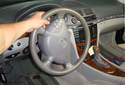 This picture illustrates the view of the steering wheel from the left side of the car.