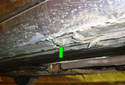 ThisPicture illustrates the right side front jack pad (green arrow).