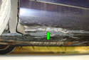 ThisPicture illustrates the right side rear jack pad (green arrow).