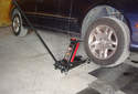 ThisPicture illustrates the right side front jack pad being used to jack up the right side of the vehicle.