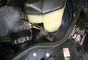 Using a pair of pliers squeeze the spring clamp and move the clamp down the hose.