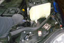 Using slip joint pliers grab the hose and twist if first to break the seal between the hose and the coolant reservoir.