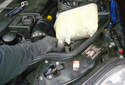 Remove the hose from the coolant reservoir.