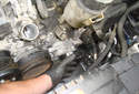 Pull the accessory drive belt tensioner away from the engine.