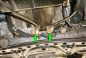 Unclip the oxygen sensor from the spring-loaded brackets (green arrows) they are held in and move them out of the way.