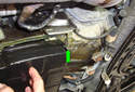 Remove the T30 Torx fastener at the front right of the transmission.