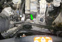 Using a long flathead screwdriver, lever the corner (green arrow) of the thermostat housing from the engine.
