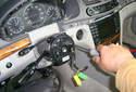 Using a Phillips head screwdriver, remove the three fasteners.