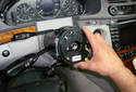 Carefully pull off the clock spring by pulling it off of the steering column shaft.