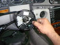Remove the steering angle sensor by pulling it away from the steering column.
