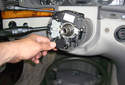 Remove the steering wheel adjustment switch by pulling it away from the steering column.