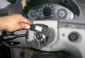 Remove the cruise control switch by pulling it away from the steering column.