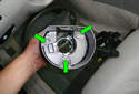 This picture illustrates the back of the turn signal switch/steering column cover.